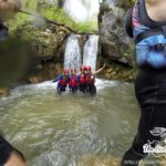 The astom group under the waterfall